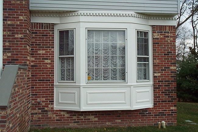 Siding installation by the top siding companies in central for Vinyl bay window